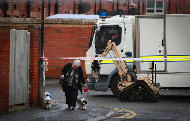 Dark days: Police at a security alert at Devonshire Place in west Belfast