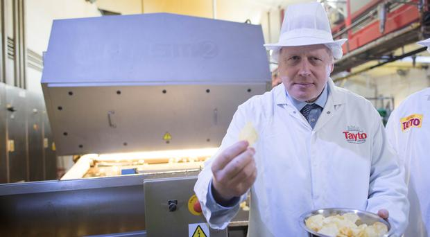 Prime Minister Boris Johnson during a visit to Tayto Castle crisp factory in Tandragee, County Armagh (Stefan Rousseau/PA)