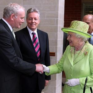 Britain's Queen Elizabeth shakes hands with Northern Ireland deputy first minister Martin McGuinness at the Lyric Theatre in Belfast.