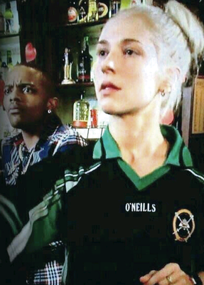 Actress Maddy Hill wearing the St Patrick's College PE top on an episode of EastEnders