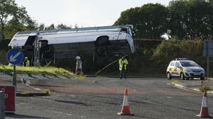 The scene of an accident on the A76 at the Crossroads roundabout near to Bowhouse Prison, Ayrshire where a bus landed on its side on a grass verge.