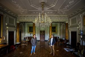 Neil Watt (left), National Trust Collections and House Manager at Castle Ward, with his partner Kris Reid standing under the chandelier in Castle Ward's reception hall which they cleaned during the pandemic. PA Photo. Picture date: Tuesday December 15, 2020. See PA story ULSTER CastleWard. Photo credit should read: Liam McBurney/PA Wire