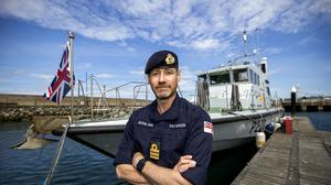 Royal Navy Senior Naval Officer Northern Ireland Commander John Patterson, pictured in front of HMS Biter (Liam McBurney/PA)