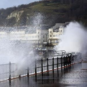 Waves crash over the promenade in Dover, Kent, as more bad weather and storms sweep across the country