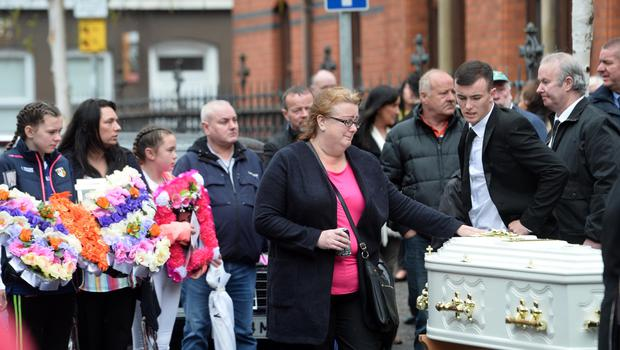 Family and friends attend the funeral of Joleen Corr at St Paul's Church in west Belfast yesterday