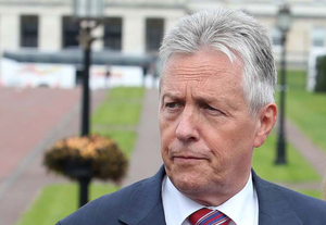 First Minister Peter Robinson speaks outside Stormont yesterday