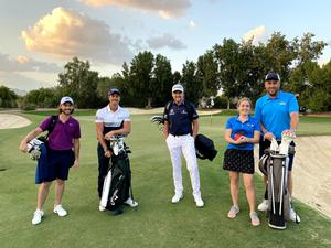 Pitch perfect: Dr Ellie McCarthy with her husband and (from left) Tommy Fleetwood, Henrik Stenson and Ian Poulter