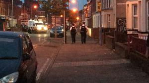 Police on patrol in the Holyland area of Belfast (Rebecca Black/PA)