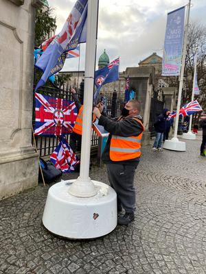 Around a dozen people marched to Belfast City Hall to mark the eighth anniversary of the Union flag dispute. The socially-distanced protesters made their way from Sandy Row Orange Hall to the city centre flanked by a number of police officers (Cate McCurry/PA)