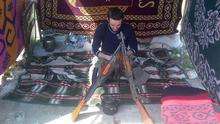 Eamon Bradley in the Middle East with a number of weapons