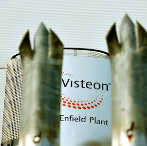 A sign at the Visteon car interior factory in Enfield, as a settlement has been reached to offer compensation to former workers