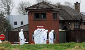 Forensic teams the day after the murder