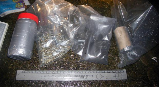 Some of the items found by police during a search of a north Belfast house, including jars wrapped in duct tape, and nails and firework powder