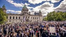 Scenes from the demonstration outside Belfast City Hall yesterday protesting over the death of George Floyd in United States