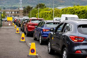 Cars queue to get into Blackstaff Way Recycling Centre in west Belfast yesterday