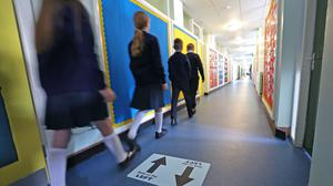 Post-primary pupils in Northern Ireland will be asked to wear face coverings in corridors and other communal areas (Liam McBurney/PA).