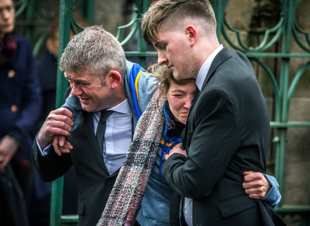 Morgan Barnard's parents Jimmy and Maria and brother Calvin at his funeral in Dungannon