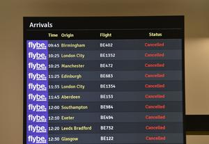 Arrivals board at Belfast City Airport yesterday