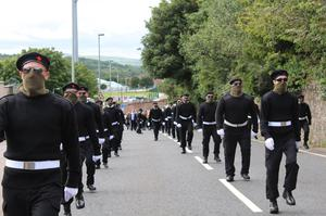 Scenes from the funeral of Peggy O'Hara in Derry on Saturday with up to 100 masked paramilitaries on show