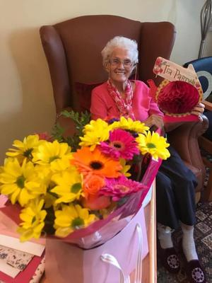 Patsy with her flowers in Macklin Care Home
