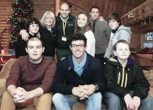 Rory McIlroy (centre front) during a visit to the Northern Ireland Cancer Fund for Children's £3m Daisy Lodge short break facility in Newcastle, Co Down