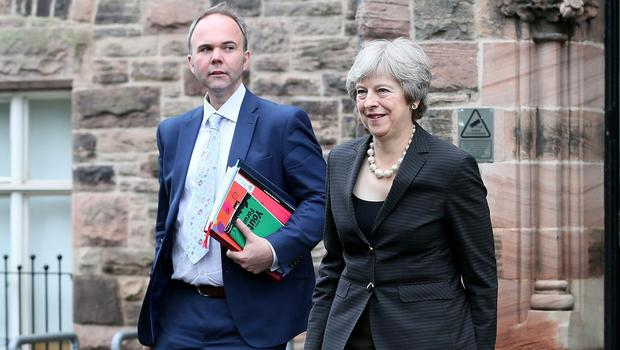 Working together: Former Prime Minister Theresa May with Chief of Staff Gavin Barwell during a visit to the Crescent Arts Centre in Belfast. Credit: Paul Faith/AFP via Getty Images