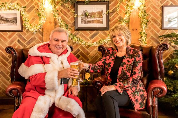 Eamonn Holmes and Ruth Langsford join guests at a charity pub event