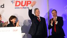 DUP leader Peter Robinson revels in the limelight after delivering his keynote address at the party's annual conference at La Mon Hotel. He is flanked by Nigel Dodds, who is the resounding favourite to succeed Robinson as leader, according to our poll