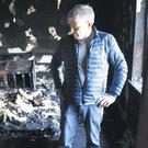 Matthew Davey inside the bedroom where his cleaner was bound and the house ransacked and set on fire
