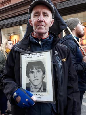 Bereaved: Gerry Armstrong with a picture of his brother Paul