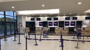 Flybe check-in desks at Belfast City Airport are empty (David Young/PA)