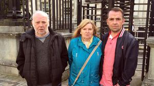Pearse Jordan's father Hugh, mother Teresa and brother Matt outside the Royal Courts of Justice in Belfast last year / Credit: PA