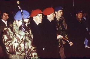 Peter Robinson (second from left) and Noel Little (right) at an Ulster Resistance rally in 1986