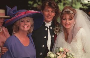 Gloria with Caron and Russ on their wedding day at St Peter's Church at Hever
