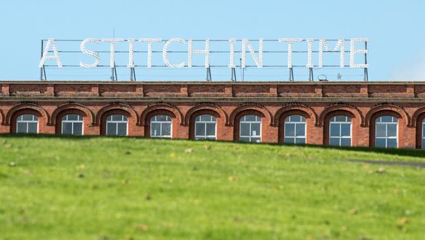 The large A Stitch in Time illumination paying homage to factory workers has been saved following a public outcry