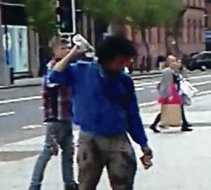 Footage of Faycal Daoud trying to set himself on fire outside Belfast City Hall last year in protest against his treatment