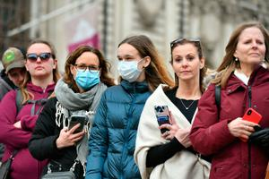 Spectators wearing masks to protect against coronavirus outside the Commonwealth Service at Westminster Abbey, London