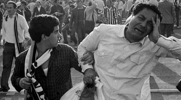 Distraught supporters flee the riots at Heysel football stadium in Brussels