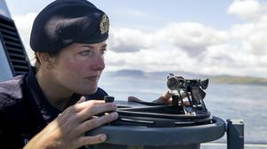 Commanding Officer Lt Rebecca Anderson Royal Navy abroad HMS Biter during Ship's in Company Close-in Manoeuvring along the north Antrim coastline. (Liam McBurney/PA)