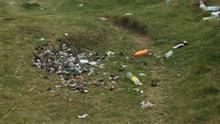 Rubbish strewn across the ground at Benone in Co Londonderry in the summer