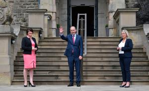 Micheal Martin arrives at Stormont to be greeted by Arlene Foster and Michelle O'Neill