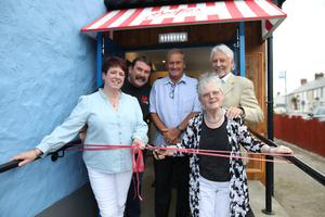 George Best's sister Barbara McNarry cuts the ribbon along with her husband Norman as they join the owners of Bestie's, Davy Cardwell, Stanley Kydd and Leigh Gamble, at the official opening