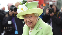 The Queen looked sprightly in her vibrant lime outfit yesterday