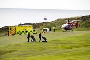 Ambulance Crews, alongside Air Ambulance Doctors with assistance from HM Coastguard assist in the Dramatic Rescue of a Fisherman who took seriously ill on the Rocks of Ardglass Golf Club, County Down C.A Kinahan/PACEMAKER PRESS
