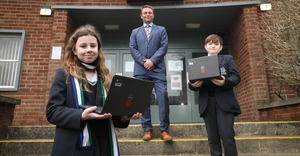 Changed days: Stephen Taylor, Principal of Blackwater Integrated College, with pupils Leah Cash and Ryan Dunlop