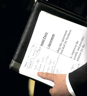 First Minister Peter Robinson with his notes during the negotiations