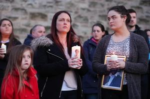 Michael McGibbon's widow Joanne with their daughters Michaela (left) and Seana at a vigil which was held in Ardoyne on Tuesday night