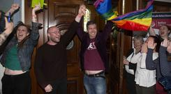Michael McCartan celebrates with his partner Mal OHara (centre) of the Green Party (Mark Marlow/PA)