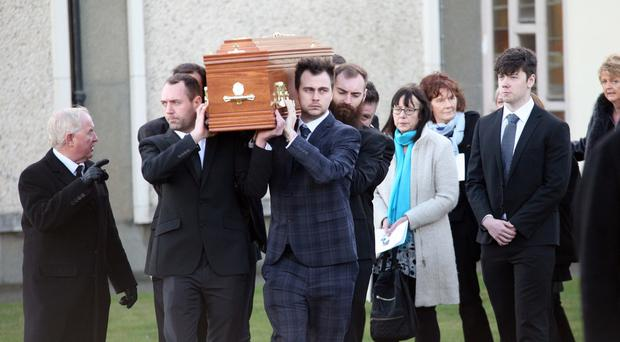 The coffin of Ernie Jones is carried out of the Church of Our Lady of the Assumption in Newcastle yesterday