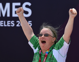 Nuala Browne from Strabane, Co Tyrone, celebrates a silver medal after finishing second in the KT 500M race singles
